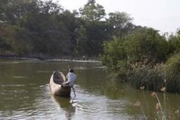 canoe rounding the river bend